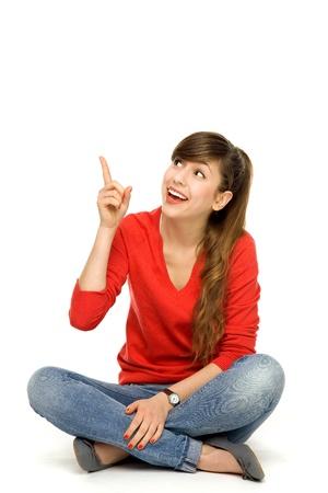 Teenage girl pointing up photo