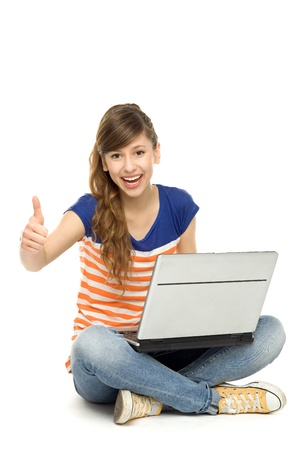 cheer full: Happy woman with laptop showing thumbs up Stock Photo