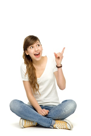 finger teen: Teenage girl pointing up Stock Photo