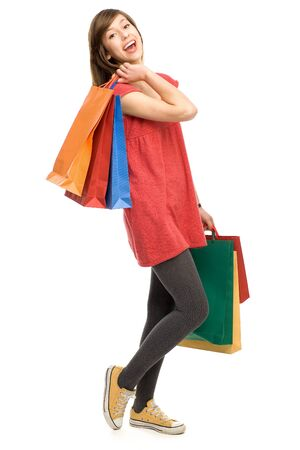 teenage girl dress: Happy young woman with shopping bags