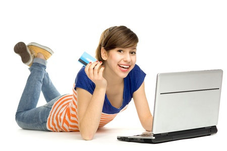 Woman holding credit card using laptop photo