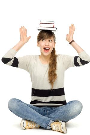 Woman balancing books on head photo