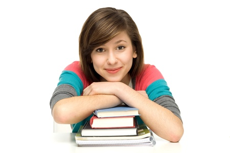 Female student leaning on books photo