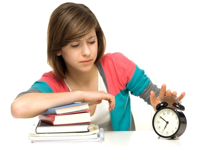 Female student turning off alarm clock photo