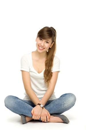 Young woman sitting photo