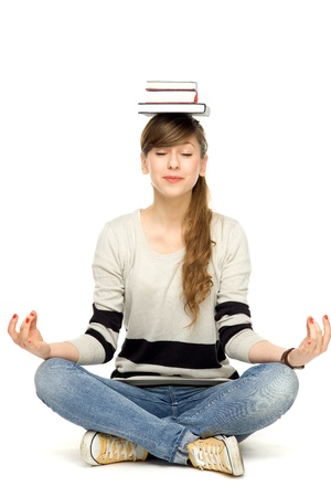 Woman balancing books on head photo