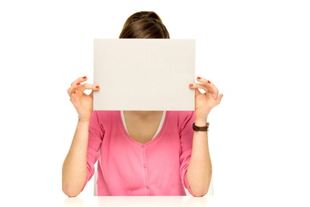 Girl covering her face with blank board Stock Photo - 12377173
