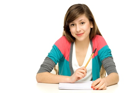 Female student doing homework photo