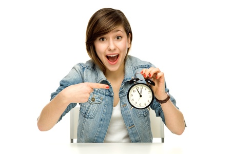 five to twelve: Woman pointing at alarm clock