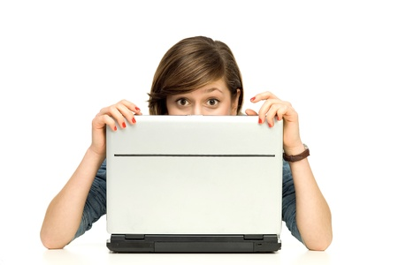 people from behind: Young woman hiding behind a laptop