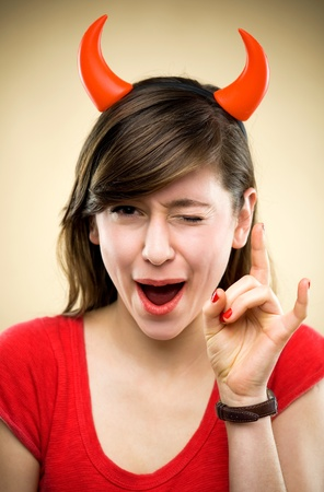 devil horns: Woman wearing devil horns Stock Photo