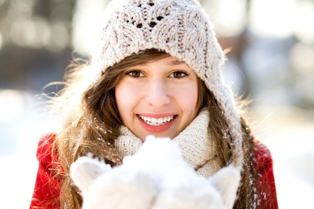 Smiling woman holding snow  photo