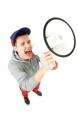 high angle shot: Young man shouting through megaphone Stock Photo