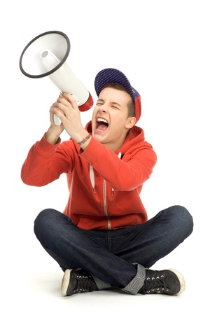 Young man shouting through megaphone photo