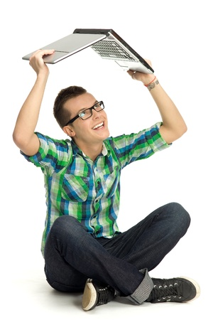 Young man holding laptop above head photo