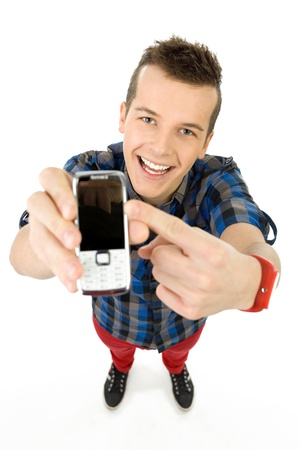 Young man showing mobile phone photo