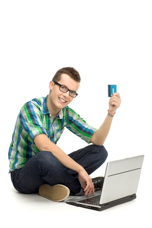 Man holding credit card using laptop photo