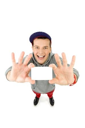 high angle shot: Teenager holding blank card