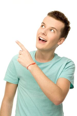 Young man pointing up photo