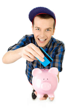 Guy with credit card and piggybank photo