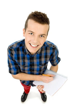 hombre escribiendo: Vista de �ngulo alto de la escritura de los estudiantes
