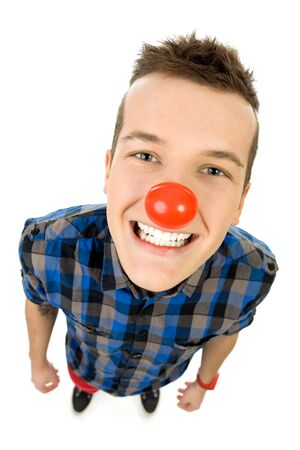 Young man wearing red nose photo