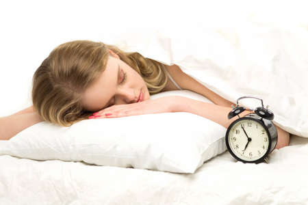Sleeping woman with alarm clock photo