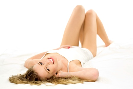 laying down: Young woman lying on bed