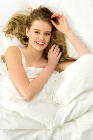 Beautiful woman lying in bed photo