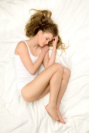 Woman sleeping on the bed Stock Photo - 12382287