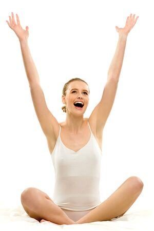 Woman in underwear with arms raised photo
