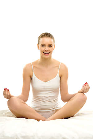 Woman sitting in yoga position  photo