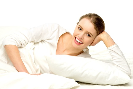 Young woman lying in bed photo