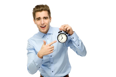 ticking: Man pointing at alarm clock