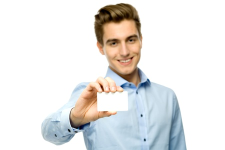 Young man holding blank card photo