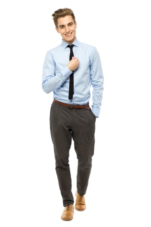 Young businessman standing photo