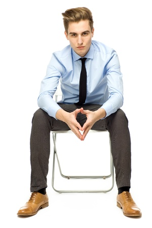 full body shot: Young businessman sitting