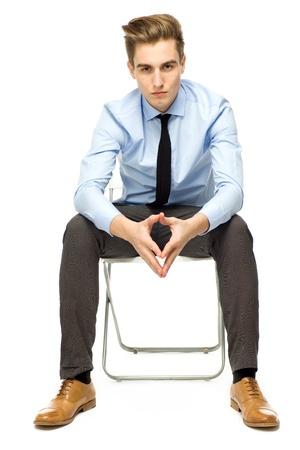 elegant business man: Young businessman sitting