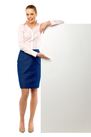 Attractive woman with blank poster photo
