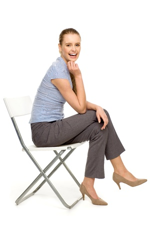 Attractive woman sitting on chair photo