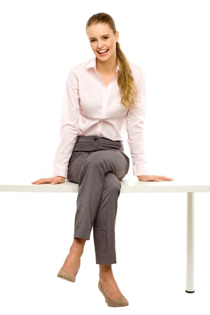Woman sitting on table with laptop photo
