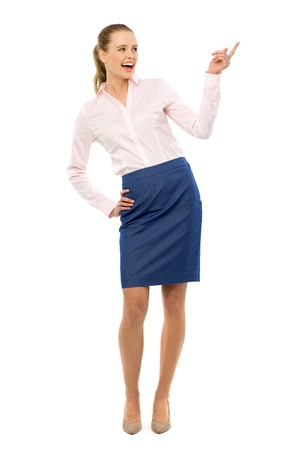 Businesswoman pointing up photo