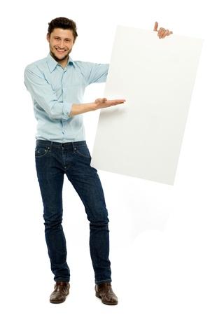 Businessman holding blank board