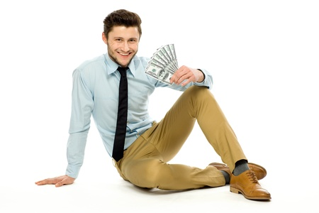 Man sitting and holding money Stock Photo - 13063149