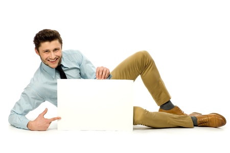 Man lying down with blank poster photo