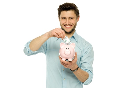 Man with piggy bank photo