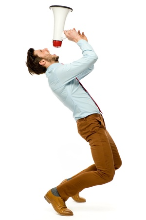 megaphone: Man shouting through megaphone Stock Photo