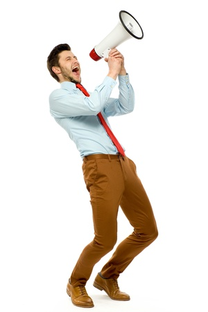 businessman using a megaphone: Businessman using megaphone