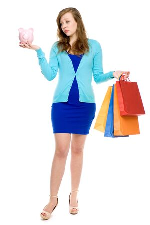 Woman with piggybank and shopping bags  photo