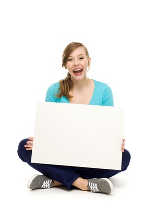 Female teenager sitting with blank poster photo